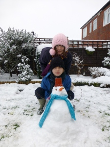 Kids and their snowman.