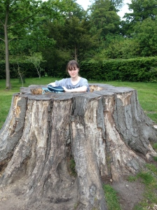 Emily resting in the tree stump.