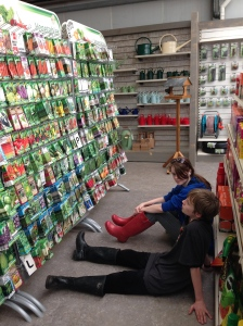 They stared at the packets of seeds in front of them. Then they sat down on the floor.