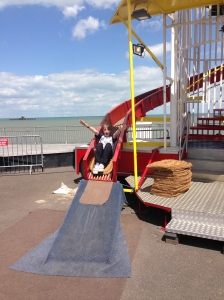 George enjoying the Helter Skelter. In the background you can ee the end of the old pier.
