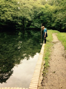Measuring the depth of the water. Too deep for a paddle George.