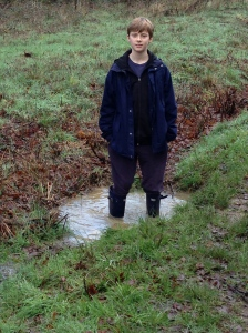 A boy is never happier than when he's standing in a puddle.