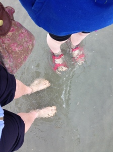We're paddling in the sea, and it's bloody cold!